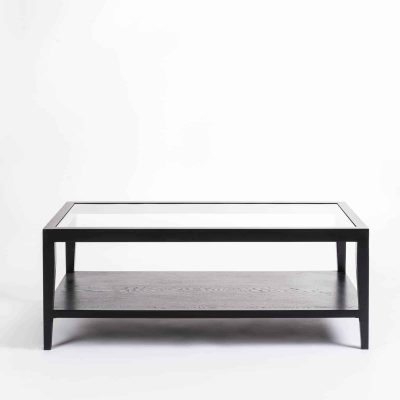 Black coffee table with glass top, solid oak and oak veneer, one shelf, tapered legs, visible grain