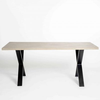 Rectangular dining table in aged oak and oak veneer, crossed black metal legs, visible grain, requires assembly