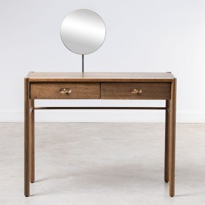 Two drawer desk in fumed oak and oak veneer, turned legs, visible grain, round style brass recessed handles, round mirror